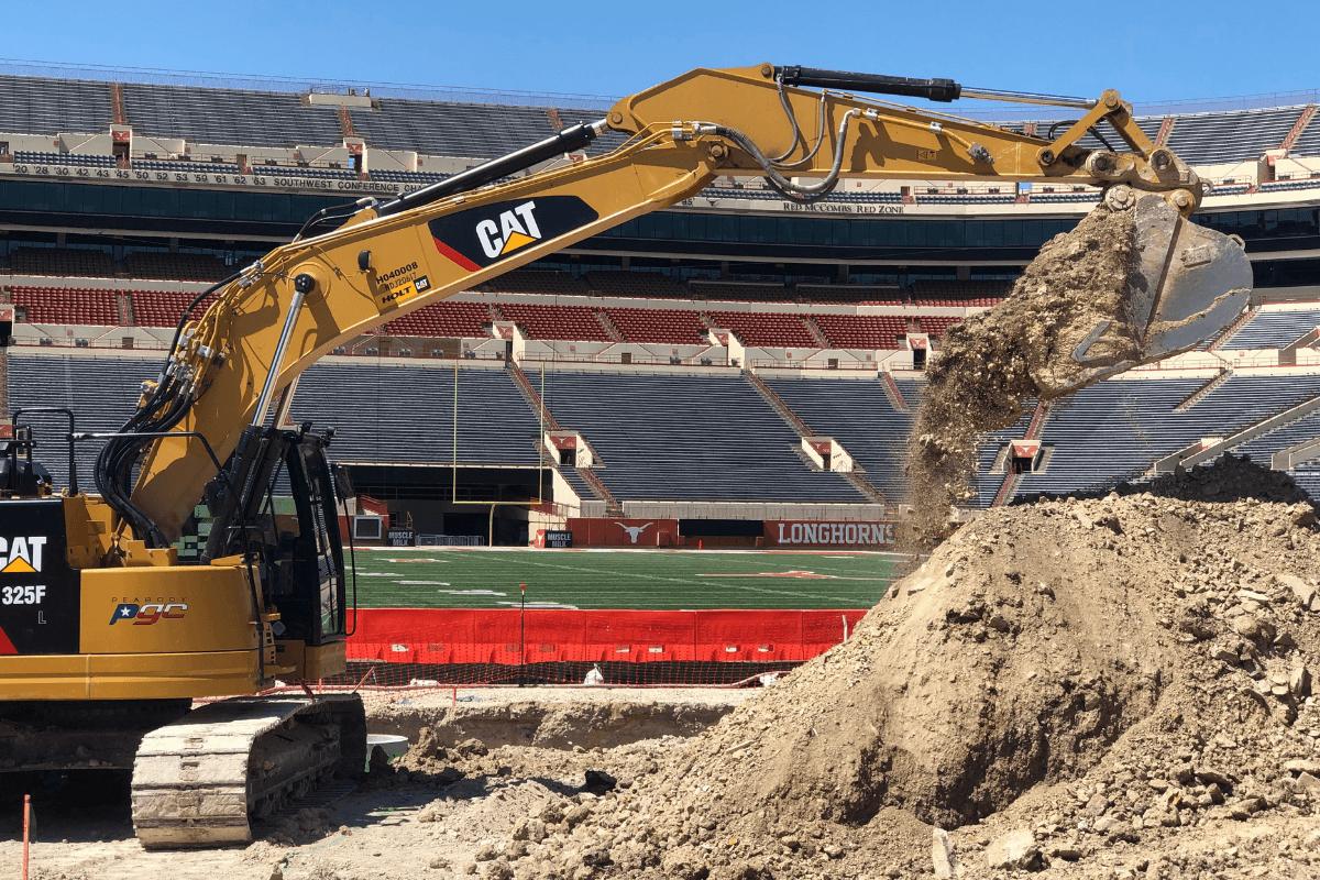 PGC Excavator pouring dirt at DKR Stadium